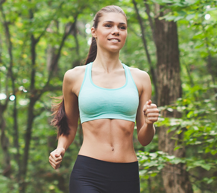 fit woman exercising in forest