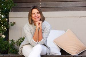 woman sitting smiling