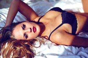 woman in lingere laying on bed