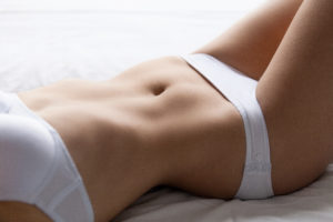 woman in lingere laying down