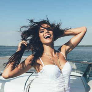 woman laughing on boat