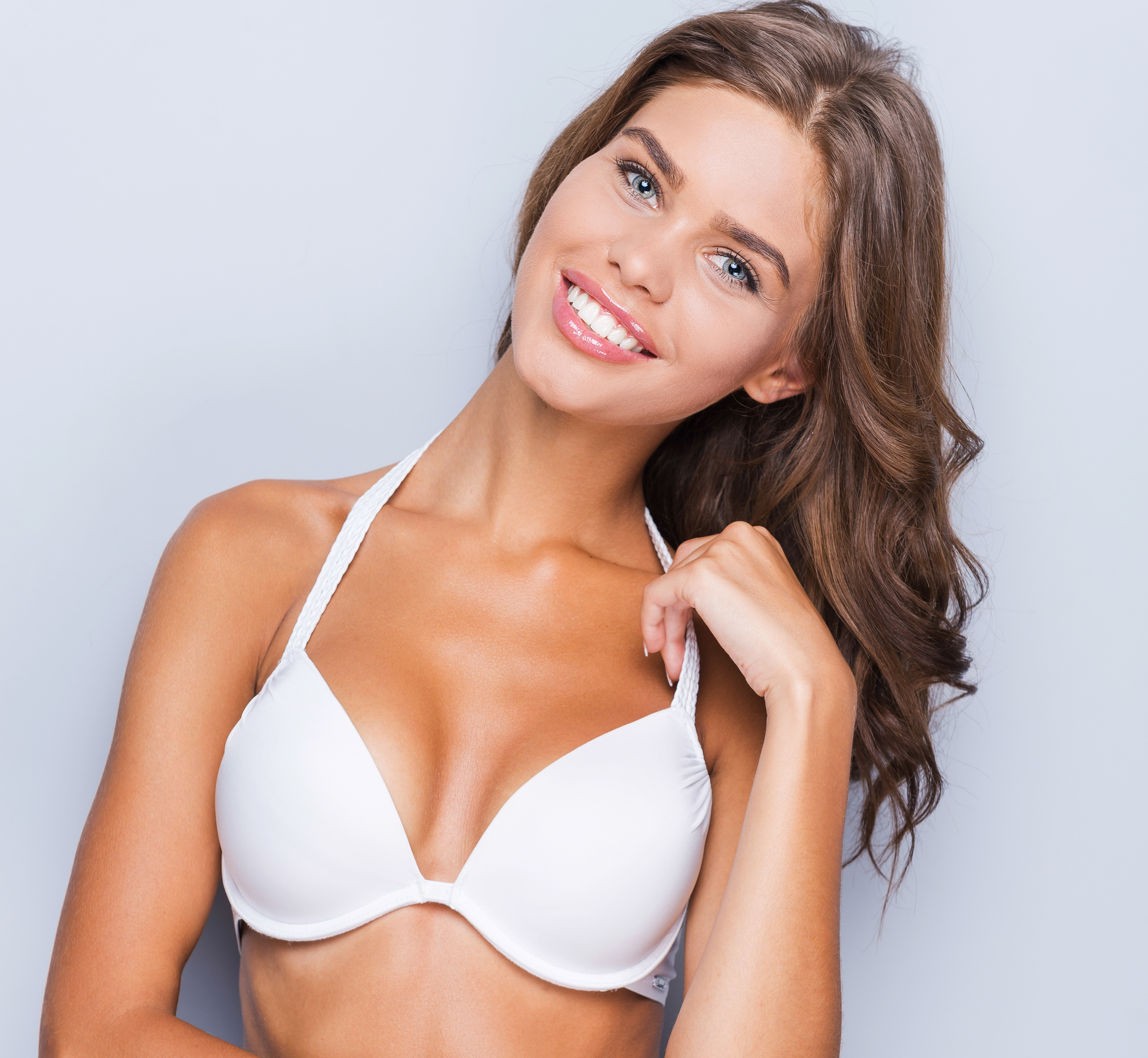 woman in lingere smiling