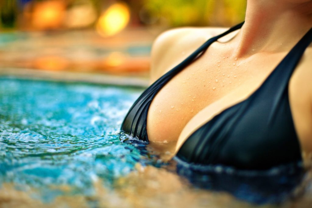 closeup of woman's breasts in pool