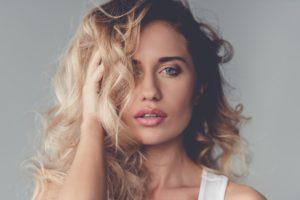woman posing holding hair