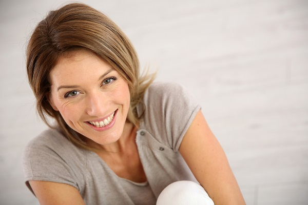 woman smiling looking upwards